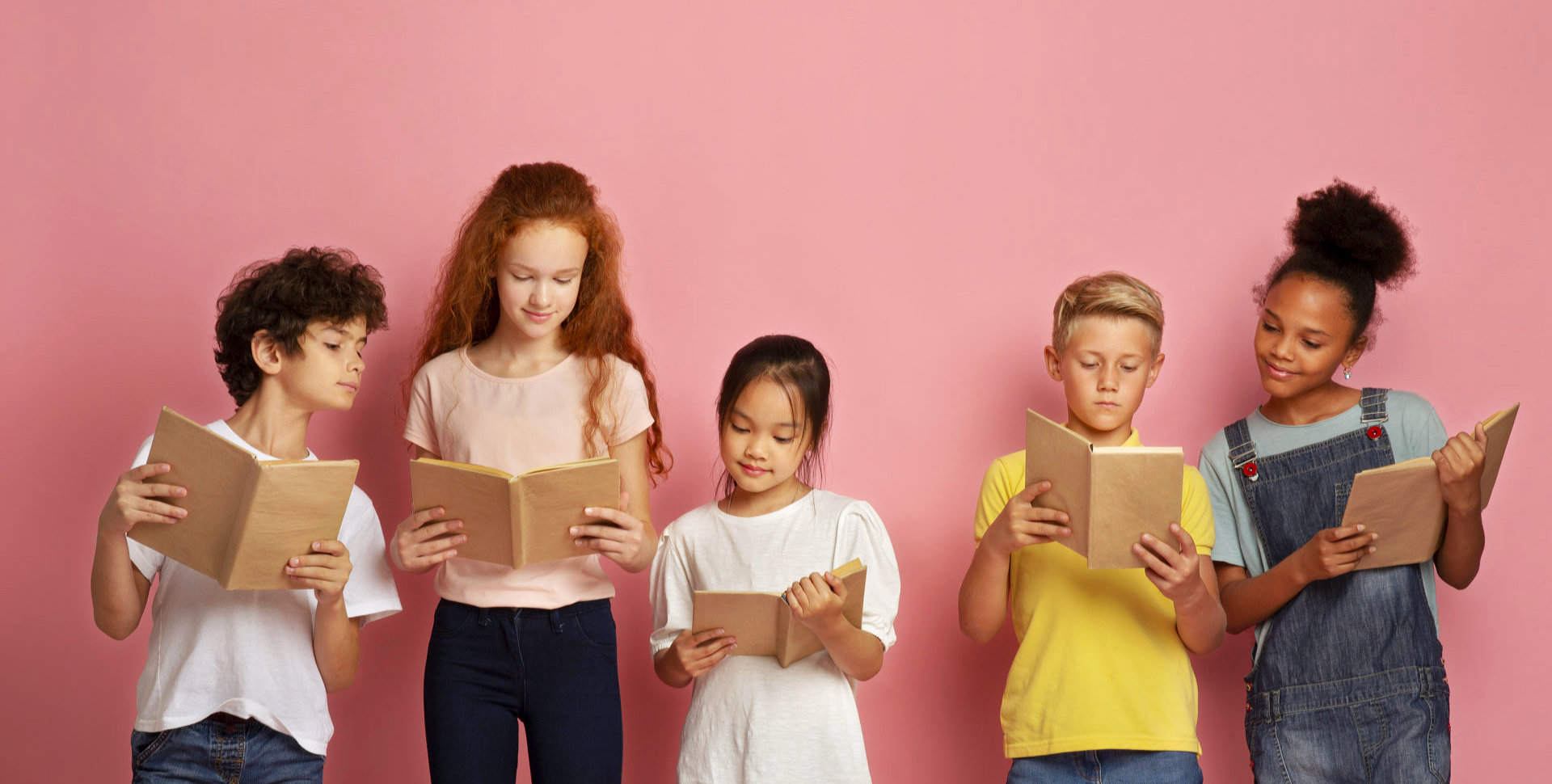 children holding a book